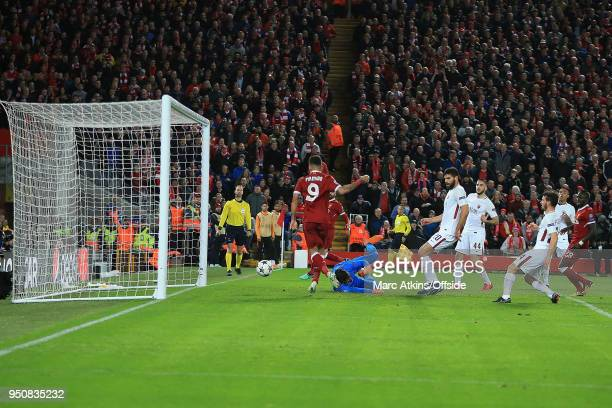 Roberto Firmino of Liverpool scores their 4th goal during the UEFA Champions League Semi Final First Leg match between Liverpool and AS Roma at...
