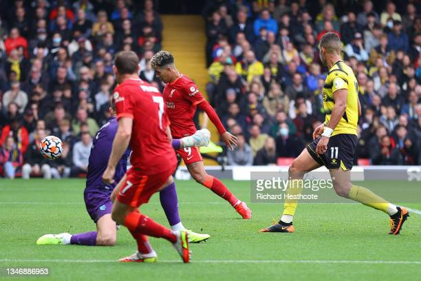 Roberto Firmino of Liverpool scores their side's second goal during the Premier League match between Watford and Liverpool at Vicarage Road on...
