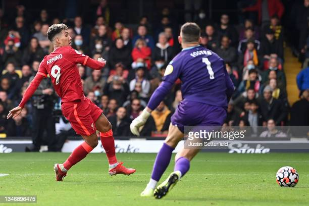 Roberto Firmino of Liverpool scores their team's fifth goal completing his hat-trick during the Premier League match between Watford and Liverpool at...