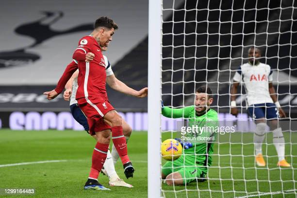Roberto Firmino of Liverpool scores their team's first goal during the Premier League match between Tottenham Hotspur and Liverpool at Tottenham...