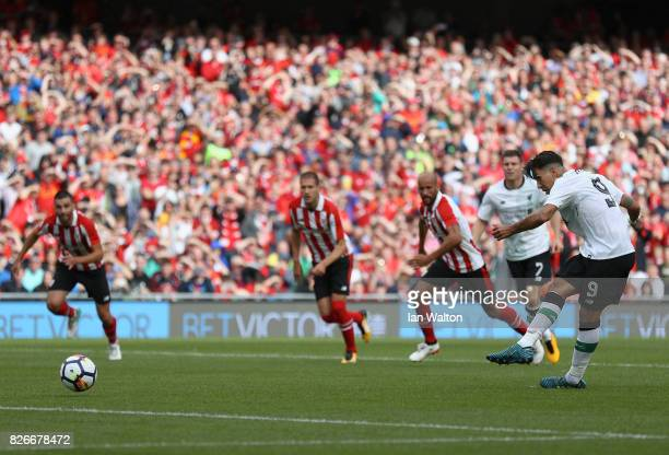 Roberto Firmino of Liverpool scores their teams first goal from the penalty spot during the Pre Season Friendly match between Liverpool and Athletic...