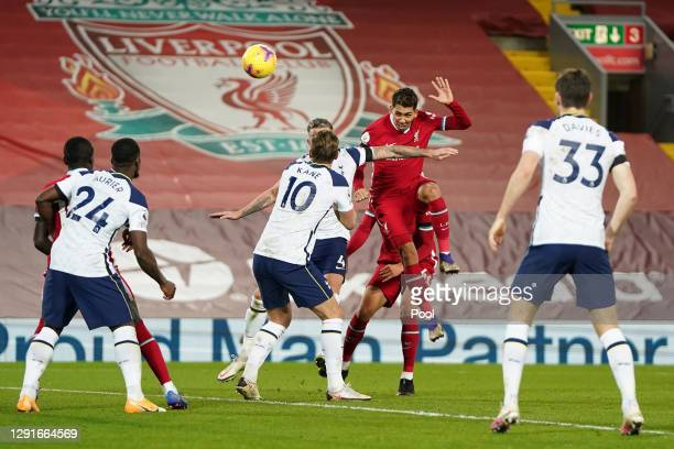 Roberto Firmino of Liverpool scores their team's second goal during the Premier League match between Liverpool and Tottenham Hotspur at Anfield on...