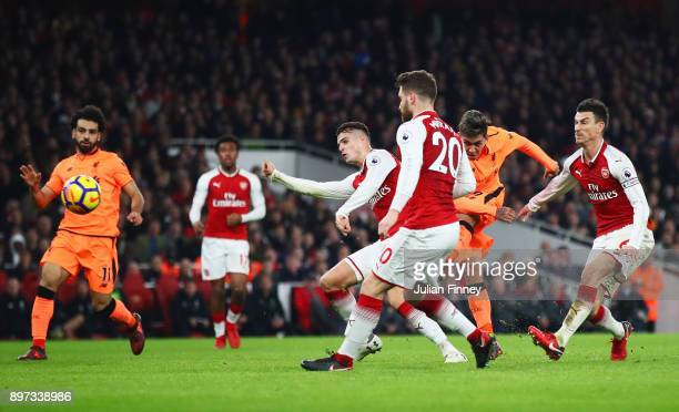 Roberto Firmino of Liverpool scores their third goal during the Premier League match between Arsenal and Liverpool at Emirates Stadium on December 22...