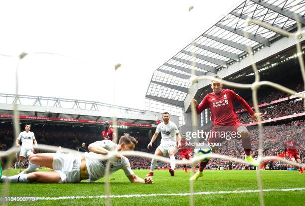 Roberto Firmino of Liverpool scores to make it 11 during the Premier League match between Liverpool FC and Burnley FC at Anfield on March 10 2019 in...