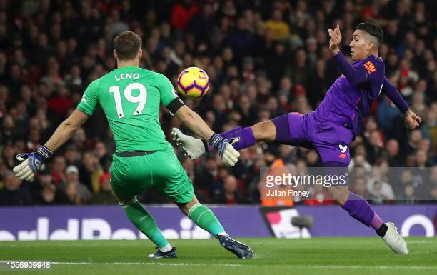 Roberto Firmino of Liverpool shoots as Bernd Leno of Arsenal looks on during the Premier League match between Arsenal FC and Liverpool FC at Emirates...