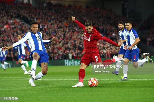 Roberto Firmino of Liverpool shoots at goal during the UEFA Champions League Quarter Final first leg match between Liverpool and Porto at Anfield on...