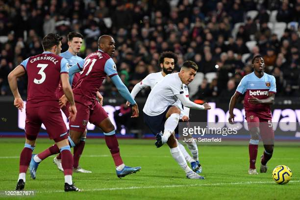 Roberto Firmino of Liverpool shoots during the Premier League match between West Ham United and Liverpool FC at London Stadium on January 29 2020 in...
