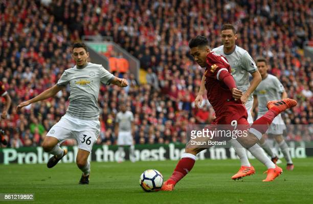 Roberto Firmino of Liverpool shoots during the Premier League match between Liverpool and Manchester United at Anfield on October 14 2017 in...