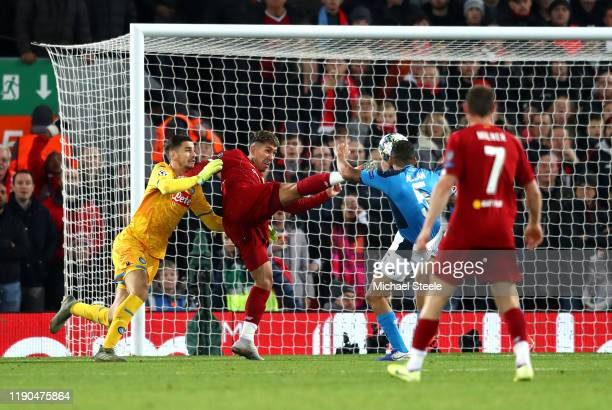 Roberto Firmino of Liverpool shoots which is then cleared off the line by Kalidou Koulibaly of Napoli during the UEFA Champions League group E match...