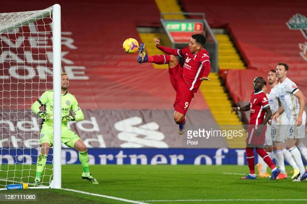Roberto Firmino of Liverpool shoots wide and misses a chance during the Premier League match between Liverpool and Leicester City at Anfield on...