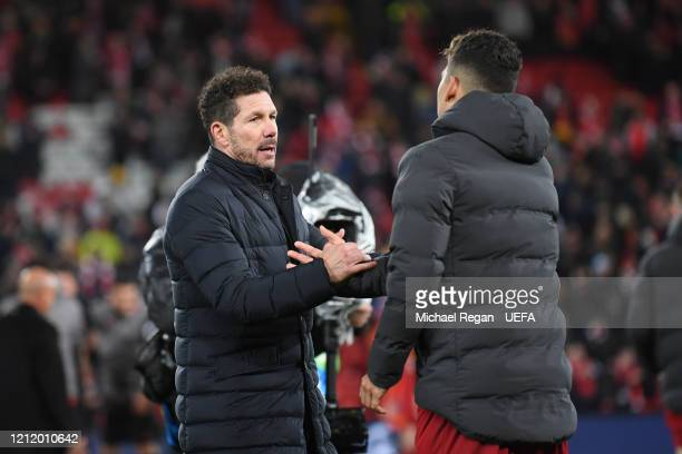 Roberto Firmino of Liverpool speaks to Atletico Madrid manager Diego Simeone after the UEFA Champions League round of 16 second leg match between...