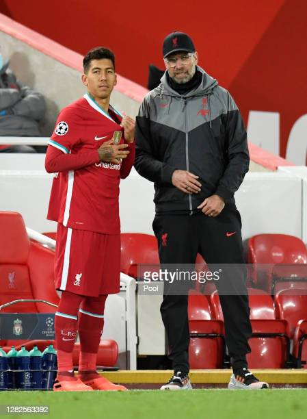 Roberto Firmino of Liverpool speaks with Jurgen Klopp Manager of Liverpool during the UEFA Champions League Group D stage match between Liverpool FC...