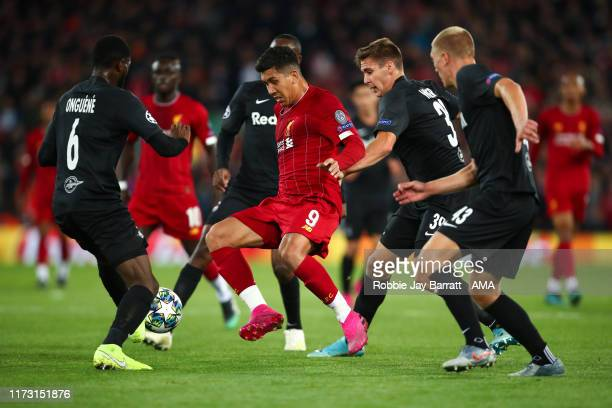 Roberto Firmino of Liverpool surrounded by RB Salzburg players during the UEFA Champions League group E match between Liverpool FC and RB Salzburg at...