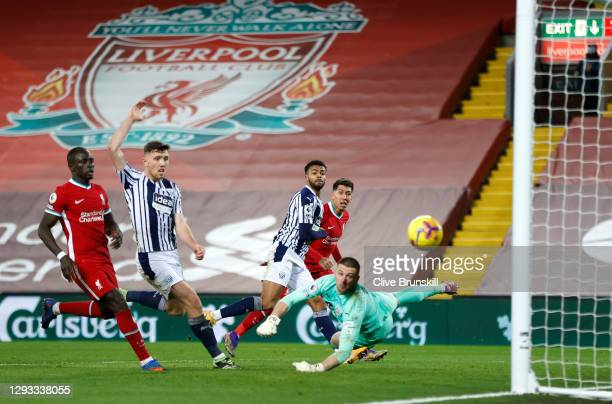 Roberto Firmino of Liverpool takes a shot that that is saved by Sam Johnstone of West Bromwich Albion during the Premier League match between...