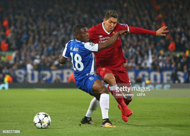 Roberto Firmino of Liverpool takes on Majeed Waris of FC Porto during the UEFA Champions League Round of 16 Second Leg match between Liverpool and FC...