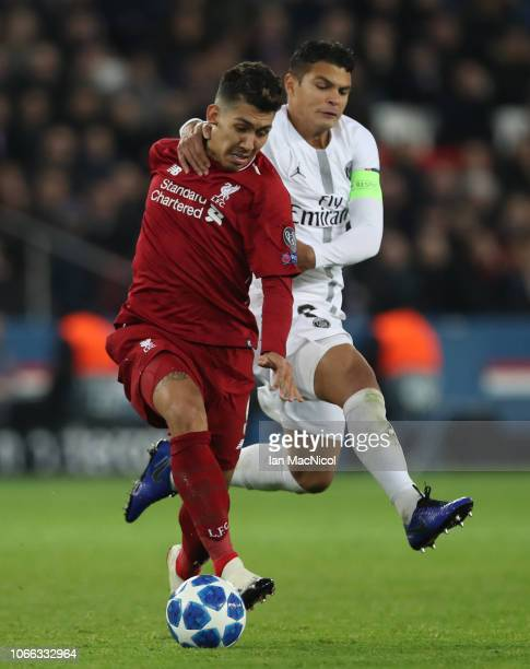 Roberto Firmino of Liverpool vies with Thiago Silva of Paris SaintGermain during the Group C match of the UEFA Champions League between Paris...