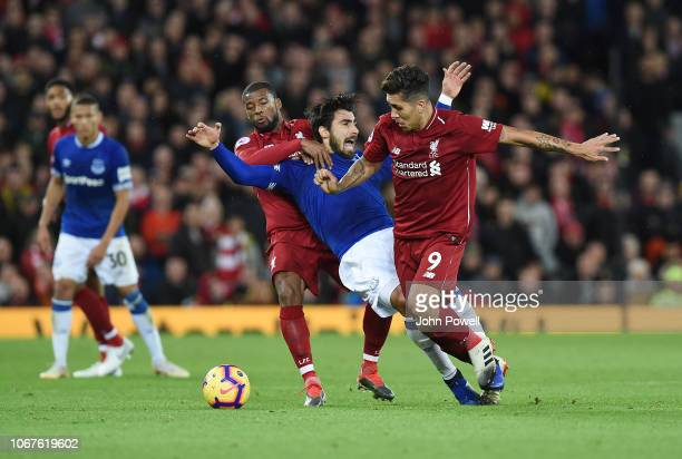 Roberto Firmino of Liverpool with Andre Gomes of Everton during the Premier League match between Liverpool FC and Everton FC at Anfield on December 2...