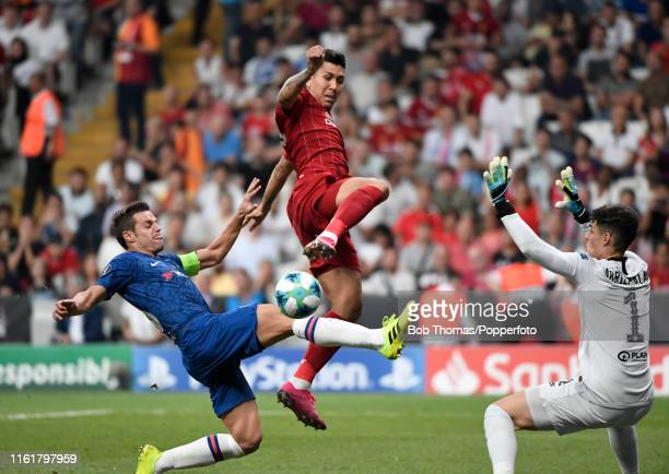 Roberto Firmino of Liverpool with Cesar Azpilicueta and goalkeeper Kepa Arrizabalaga of Chelsea during the UEFA Super Cup match between Liverpool and...