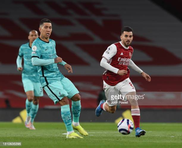 Roberto Firmino of Liverpool with Dani Ceballos of Arsenal during the Premier League match between Arsenal and Liverpool at Emirates Stadium on April...