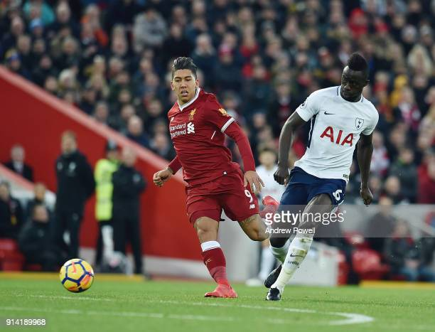 Roberto Firmino of Liverpool with Davinson Sanchez of Tottenham during the Premier League match between Liverpool and Tottenham Hotspur at Anfield on...