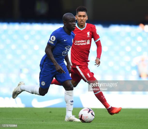 Roberto Firmino of Liverpool with N'Golo Kante of Chelsea during the Premier League match between Chelsea and Liverpool at Stamford Bridge on...