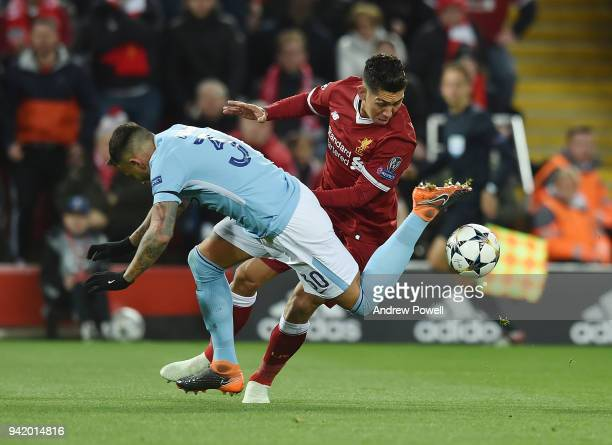 Roberto Firmino of Liverpool with Otamendi of Manchester City during the UEFA Champions League Quarter Final Leg One match between Liverpool and...