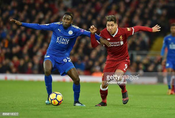 Roberto Firmino of Liverpool with Wilfred Ndidi of Leicester during the Premier League match between Liverpool and Leicester City at Anfield on...