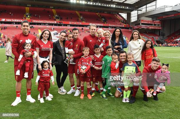 Roberto Firmino Philippe Coutinho Lucas Leiva and Dejan Lovren and Alberto Moreno of Liverpool pose with families at the end of the Premier League...