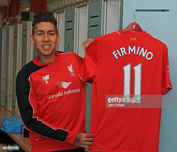 Roberto Firmino poses with his shirt on his first day at Liverpool FC at Melwood Training Ground on July 22 2015 in Liverpool England