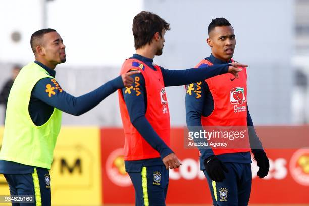 Roberto Firmino Rodrigo Caio and Alex Sandro of Brazil exercise during a training session ahead of International Friendly Match between Russia and...
