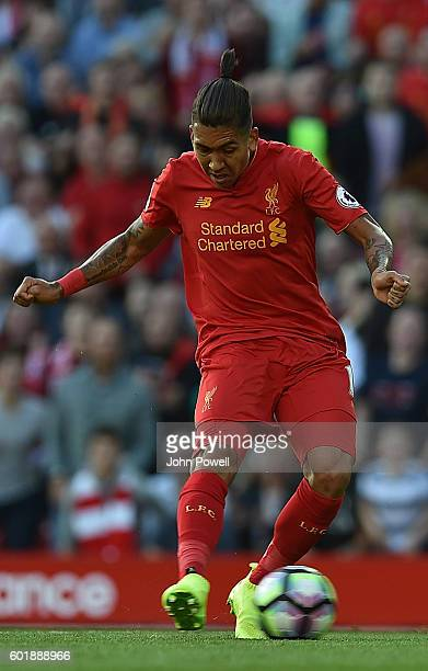 Roberto Firmino Scores Liverpools First Goal during the Premier League match between Liverpool and Leicester City at Anfield on September 10 2016 in...