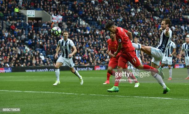 Roberto Firmino Scores putting Liverpool ahead during the Premier League match between West Bromwich Albion and Liverpool at The Hawthorns on April...
