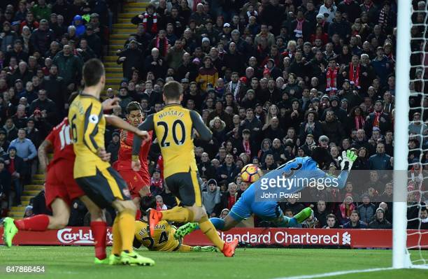 Roberto Firmino Scores the opener for liverpool during the Premier League match between Liverpool and Arsenal at Anfield on March 4 2017 in Liverpool...