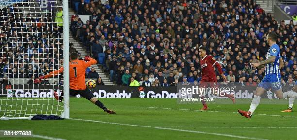 Roberto Firmino Scores The Second for Liverpool during the Premier League match between Brighton and Hove Albion and Liverpool at Amex Stadium on...