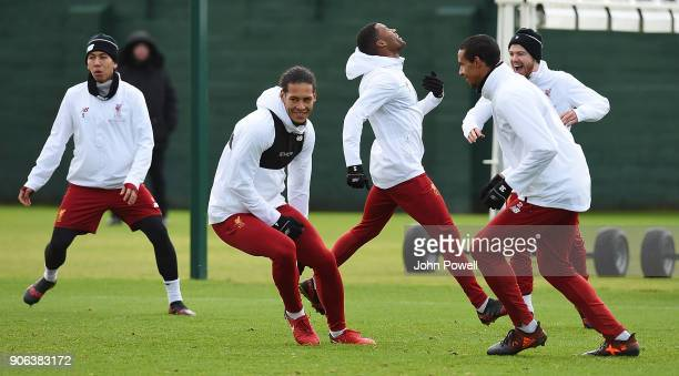 Roberto Firmino Virgil van Dijk Georginio Wijnaldum Joel Matip and Alberto Moreno of Liverpool during a training session at Melwood Training Ground...