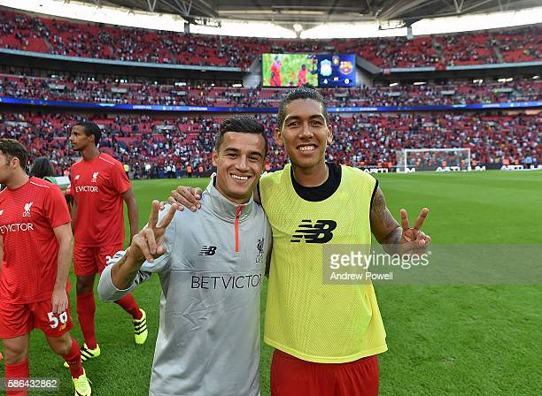 Roberto Firmino with Philippe Coutinho of Liverpool at the end of the International Champions Cup match between Liverpool and Barcelona at Wembley...