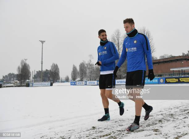 Roberto Gagliardin and Milan Skriniar of FC Internazionale chat during the FC Internazionale training session at the club's training ground Suning...