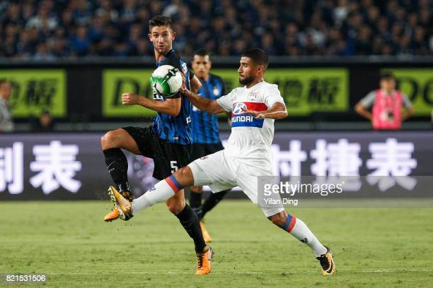 Roberto Gagliardin of FC Internationale and Sergi Darder Moll of Olympique Lyonnais fight for the ball during the 2017 International Champions Cup...