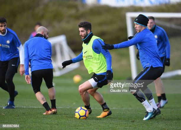 Roberto Gagliardini and Ivan Perisic of FC Internazionale compete for the ball during the FC Internazionale training session at Suning Training...