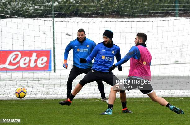 Roberto Gagliardini and Lisandro Lopez of FC Internazionale compete for the ball during the FC Internazionale training session at the club's training...