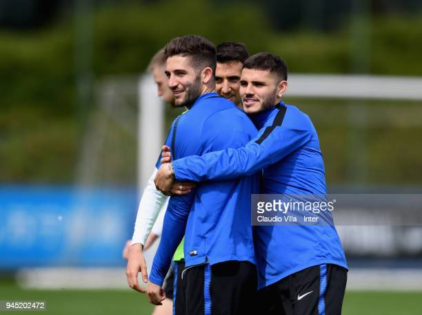Roberto Gagliardini and Mauro Icardi of FC Internazionale chat during the FC Internazionale training session at the club's training ground Suning...