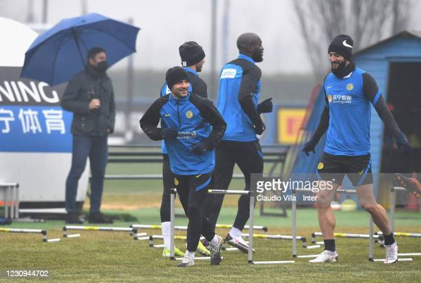 Roberto Gagliardini and Stefano Sensi of FC Internazionale in action during a training session at Appiano Gentile on February 3, 2021 in Como, Italy.