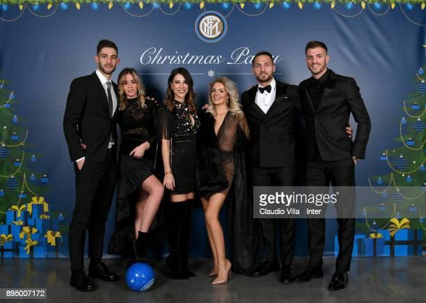 Roberto Gagliardini Danilo D'Ambrosio and Davide Santon of FC Internazionale with their wives pose for a photo during a FC Internazionale Christmas...