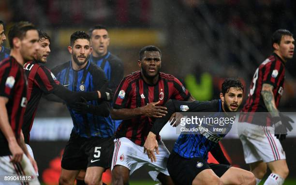 Roberto Gagliardini of FC Internazionale and Andrea Ranocchia of FC Internazionale competes for the ball with Franck Kessie of AC Milan during the...