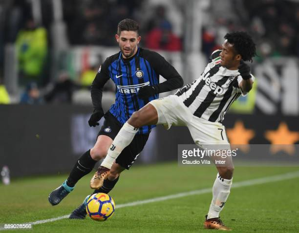Roberto Gagliardini of FC Internazionale and Juan Cuadrado of Juventus FC compete for the ball during the Serie A match between Juventus and FC...