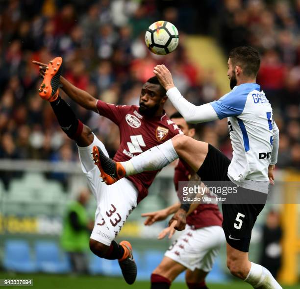 Roberto Gagliardini of FC Internazionale and Nicolas Alexis Julio N'Koulou N'Doubena of Torino FC compete for the ball during the serie A match...