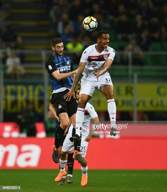Roberto Gagliardini of FC Internazionale and Senna Miangue of Cagliari Calcio compete for the ball in action during the serie A match between FC...