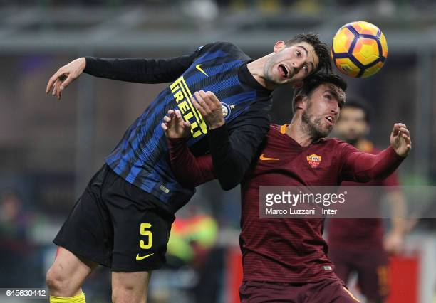 Roberto Gagliardini of FC Internazionale competes for the ball with Kevin Strootman of AS Roma during the Serie A match between FC Internazionale and...