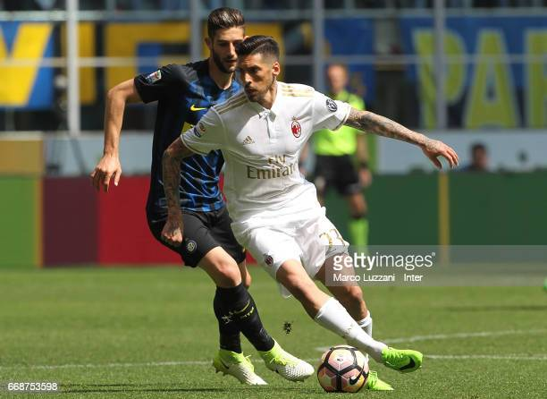 Roberto Gagliardini of FC Internazionale competes for the ball with Jose Sosa of AC Milan during the Serie A match between FC Internazionale and AC...