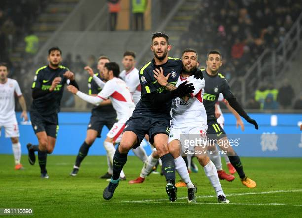 Roberto Gagliardini of FC Internazionale competes for the ball with Salvatore Burrai of Pordenone during the TIM Cup match between FC Internazionale...